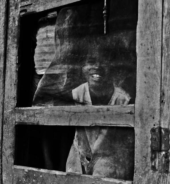 kid behind door
