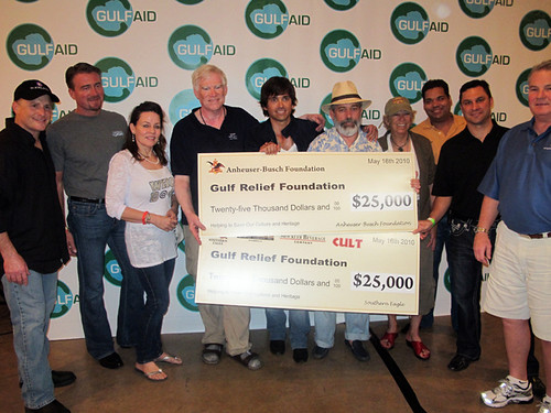 Anheuser-Busch and Mockler Beverages present checks to the Gulf Relief Foundation. That's WWOZ GM David Freedman 4th from left!