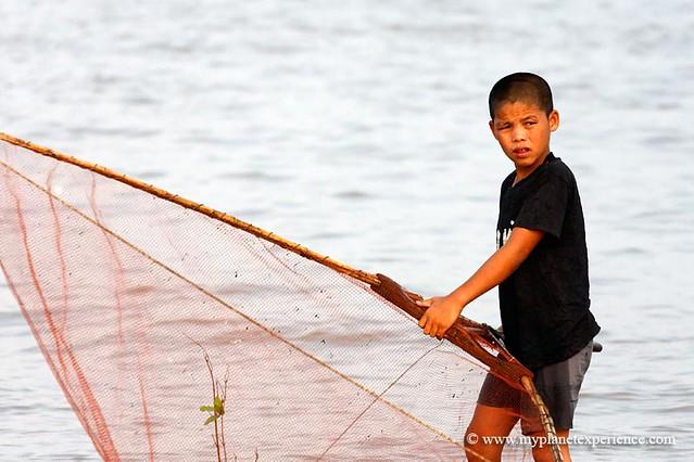 A young fisherman - Tonle Sap Lake, Cambodia
