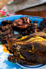 Barbequed dog head and meat | Phnom Penh, Cambodia | by bokehcambodia