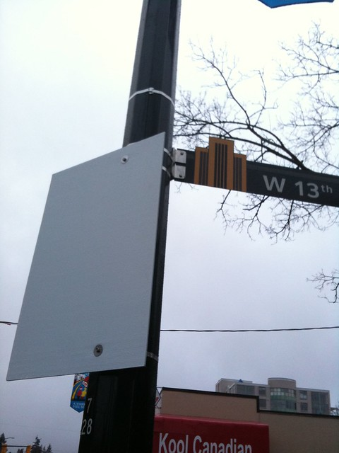 Front of the Olympic Lane sign on Cambie and 13th (backwards for now)