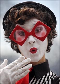 Unveiled | Feminine Joker Face blowing a kiss. Big fat