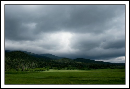 light mountains field clouds colorado stormy pasture drama