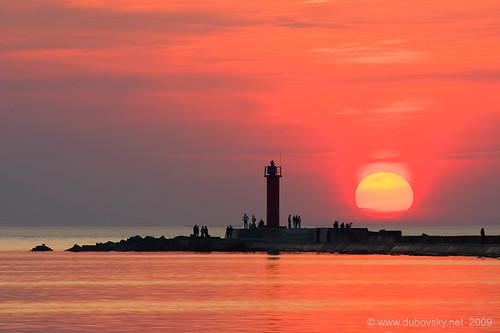 sunset sea sun lighthouse baltic latvia riga daugava