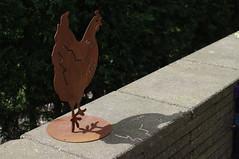 flat metal chicken sculpture