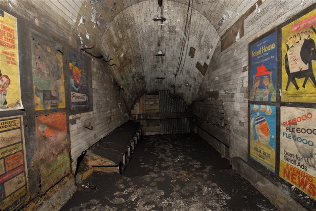 Disused passageway with vintage 1959 posters, Notting Hill Gate tube station, London, 2010