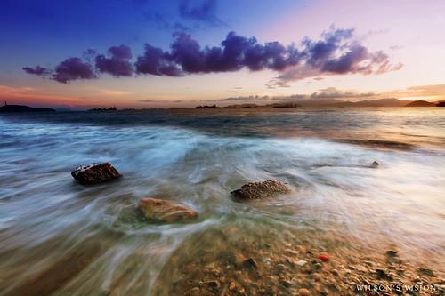 longexposure sunset sea hk sun beach water rock misty canon hongkong sandy tide rocky wave 5d 1635 pokfulam sandybay 1635mm 5dmarkii wilsonsvision