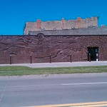 Scenes from behind the wheel, Hand-Carved Brick Mural