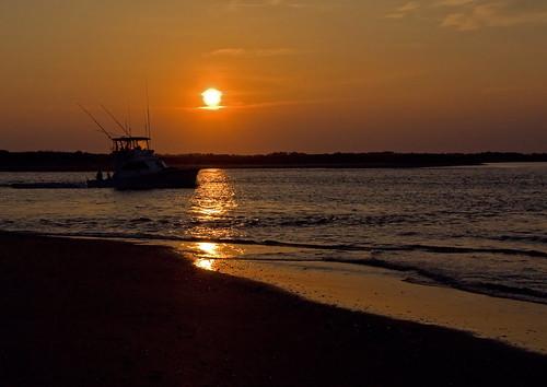 ocean sun beach water sunrise reflections boat nc fishing sand surf ship northcarolina intercoastalwaterway goldenball holdenbeach charterboat davidhopkinsphotography