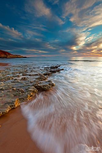 ocean sunset sky cloud sun seascape motion beach nature water clouds seashells canon sand rocks surf waves shell australia wideangle filter adelaide southaustralia 1740 portnoarlunga leefilters canon5dmkii 5dmkii daleallman