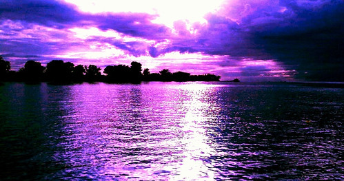 ocean sunset sun storm reflection beach water sunshine clouds sunrise river pier waves florida horizon tropical bradenton darkclouds purplesky manateeriver annamariaisland manateecounty