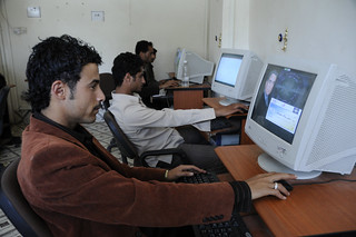 Patrons use computers in an internet cafe | by World Bank Photo Collection