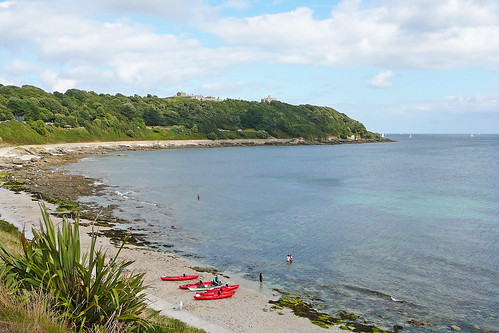 Red canoes on Castle Beach, Falmouth | by Tim Green aka atoach