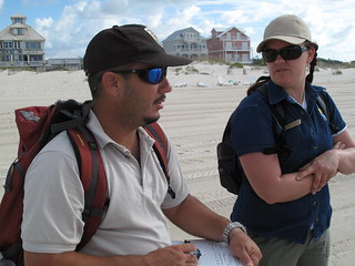 Carlos Pacheco and Kristen Gilbert discussing the beach bird study. Gulf Shores, Alabama