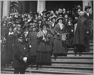 "Members of the ""Liberty Loan Choir"" singing on the steps of City Hall, New York City, in the third Liberty Loan campaign. At the right is Bishop William Wilkinson, who led the choir., 04/1918"