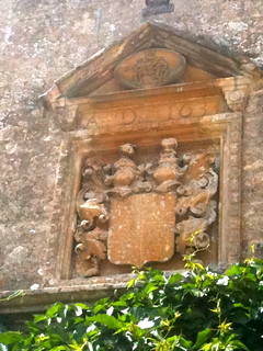 Close up of stone carving above the entrance of Bibury Court Hotel | by Tip Tours