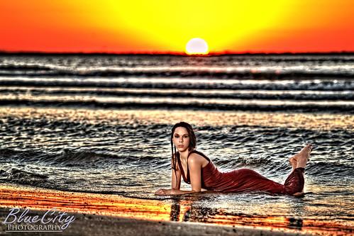 ocean light portrait sky orange gulfofmexico water sunrise pose dawn model sand shoot texas dress tx picture professional freeport lakejackson surfside angleton quintanabeach modelmayhem brazoriacounty bluecityphotography bluecityphotographycom