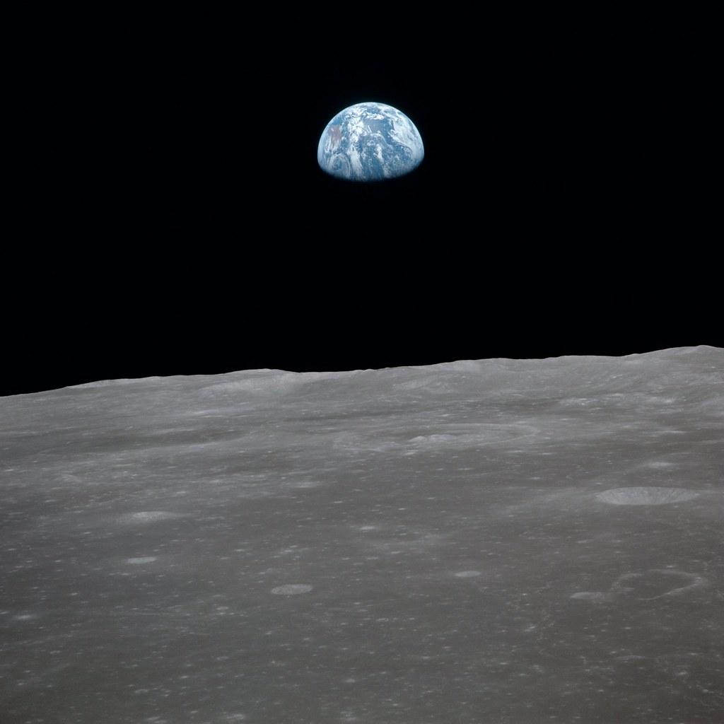 Apollo 11 Mission Image - View of moon limb with Earth on the horizon, Mare Smythii Region