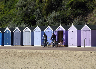 Biking by blue beach huts | by wit