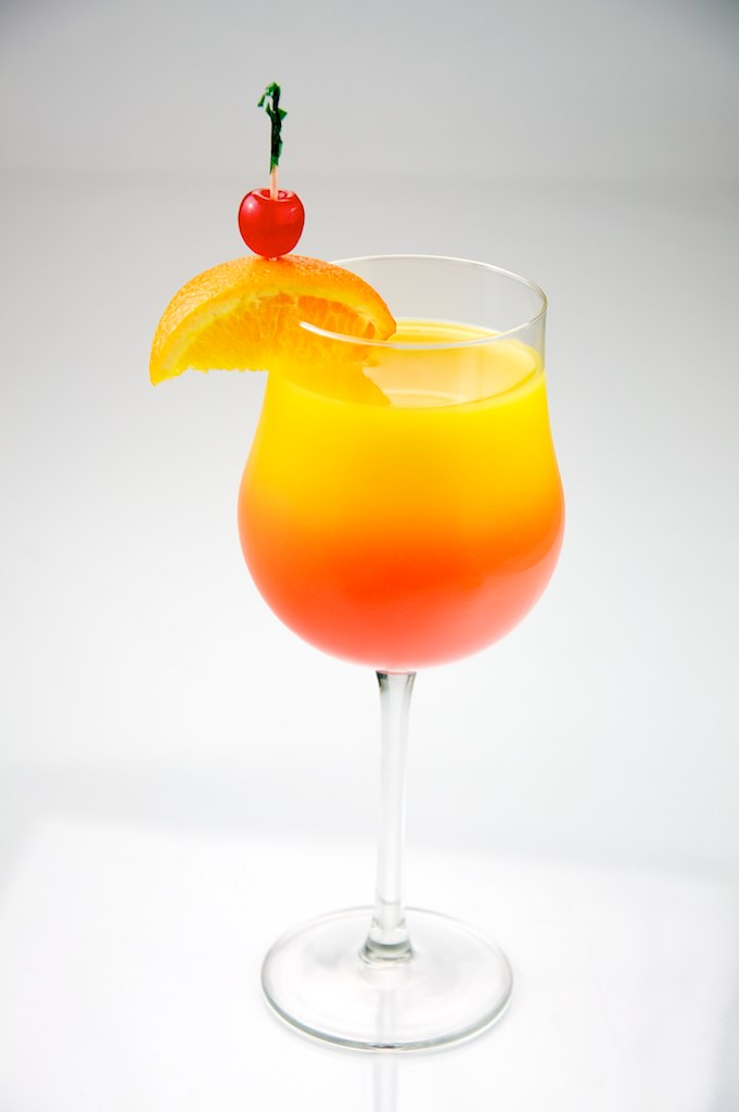 Tequila Sunrise | Tequila Sunrise garnished with orange and … | Flickr