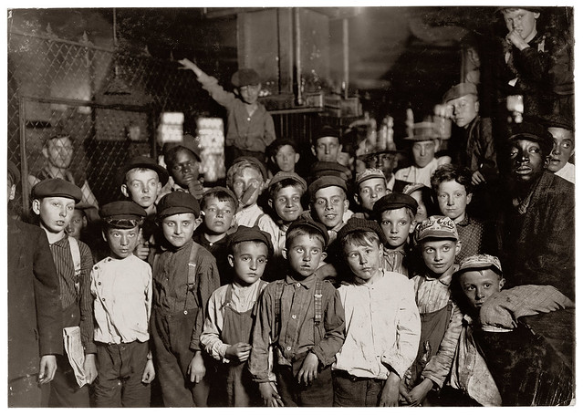 Indianapolis newsboys waiting for the Base Ball edition in a newspaper office. August 1908