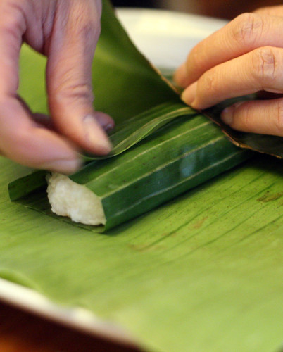 Preparing suman: wrapping the rice mixture | by eselcee