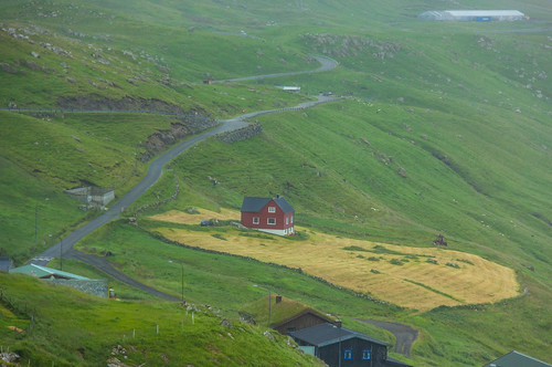 Rain in Velbastaður. The red house úti í Dølum, Faroe Islands | by thorrisig