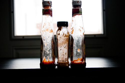 nearly empty sauce bottles | by Steve A Johnson
