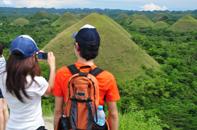 Couple taking photo of Chocolate Hills