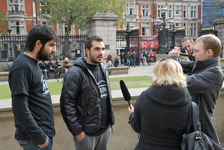 Giving interviews after the protest   by elginism