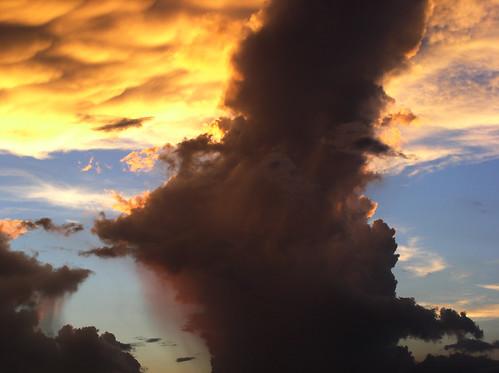 sunset wild sky cloud sun sunlight nature beautiful rain weather silhouette backlight clouds spectacular outdoors shower evening amazing skies natural sunsets bluesky cumulus backlit sunsetting backlighting cumulonimbus rainshower cumulusclouds cumuluscloud justclouds cloudsilhouette orangerain