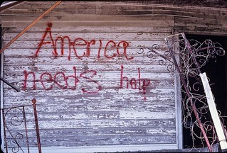"New-Orleans post Katrina 2006: ""America needs help"" graffiti on abandoned house. 