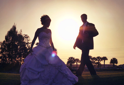 wedding sunset woman man love silhouette youth golf lens solar couple florida course tango flare timeless verobeach cymk