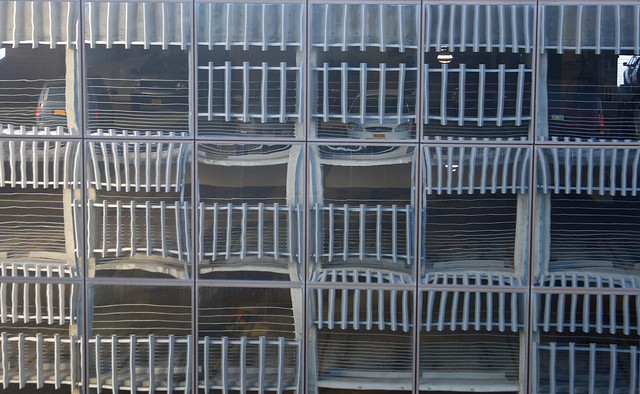 Parking garage reflected on the Atwood Center