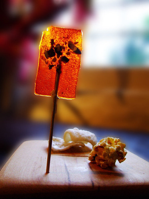 Red pepper and chilli lollipop with spiced popcorn and cheese/seaweed crackers