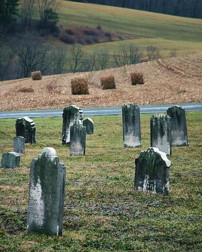 graveyard cemetery gravestones tombstones tombs graves haybales field country himmelschurch rebuck pennsylvania