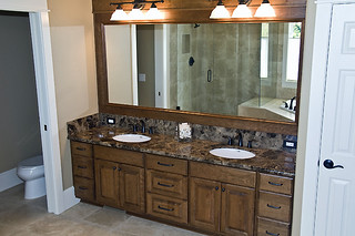 Custom cherry cabinets & granite vanity | by Sitka Projects LLC
