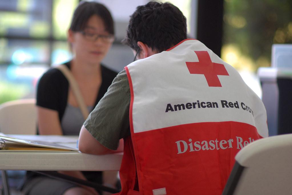 Shelter registration | An American Red Cross volunteer helps