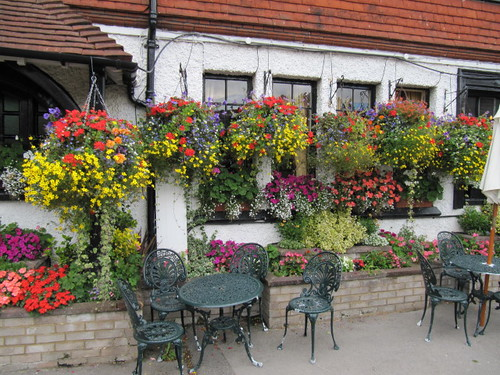 Wall with hanging baskets.