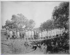 The children from the Lower Light School standing on the foot bridge that crosses the Light River