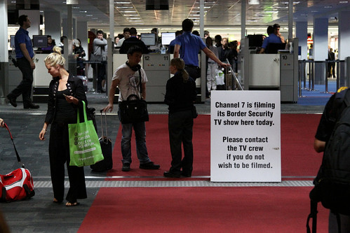 """Sign warning passengers at Melbourne Airport that Channel 7 is filming the TV show """"Border Security"""" today"""