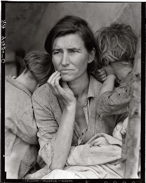 Destitute pea pickers living in tent in migrant camp Mother of seven children Age thirty-two Nipomo, California February 1936 Photograph by Dorothea Lange