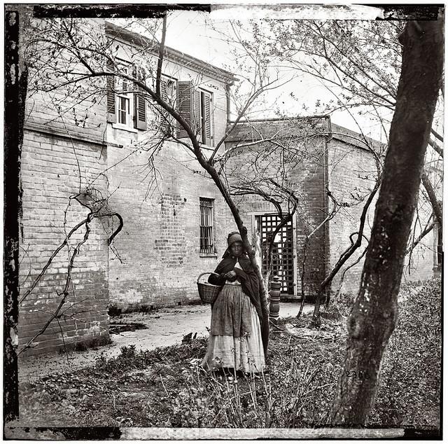 Exterior view of Price, Birch & Co. slave pen at Alexandria, Virginia, circa 1865. Wet collodion, half of glass plate stereograph pair.