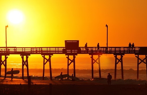 morning orange sunrise pier surf surfers