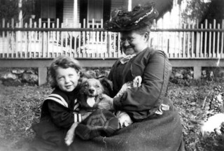 Boy, dog and woman enjoying each other's company: Tallahassee, Florida   by State Library and Archives of Florida