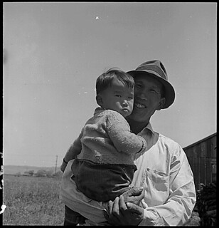 San Lorenzo, California. Farm laborer with his little son a few days prior to evacuation from this . . ., 05/05/1942