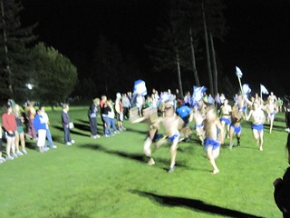 Crazy high school boys running half naked and barefoot