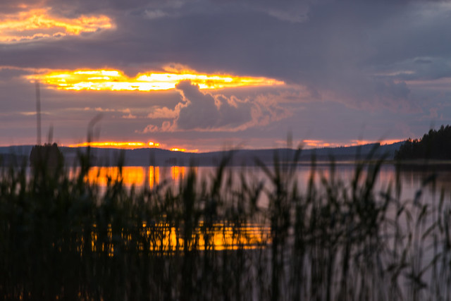 sunset showing trough clouds and reflecting from a lake