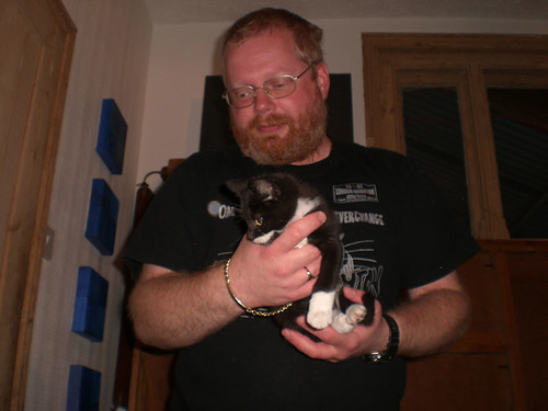 Big man and little kitten