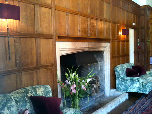 Fireplace in the waiting room of Bibury Court Hotel | by Tip Tours